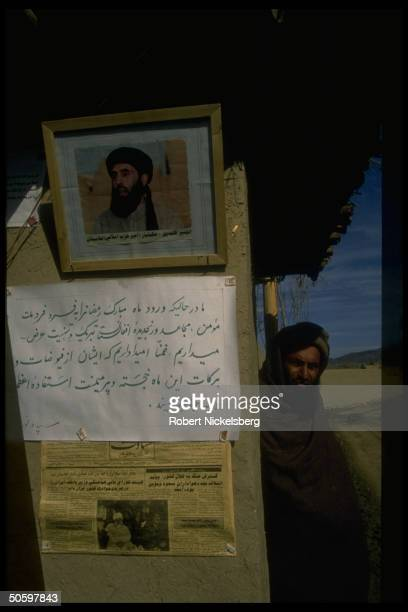 Pic of PM Gulbuddin Hekmatyar Arabic sign old newspaper clipping on facade prob of structure at/nr antiRabbani govt renegade PM's base in Charasiab