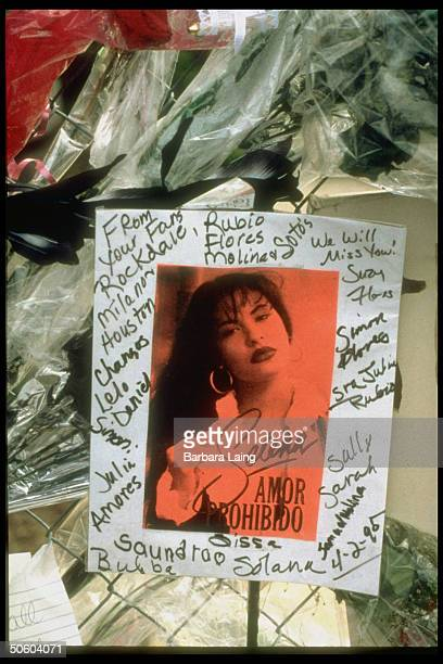Pic of Tejano singer Selena signed by fans hanging on fence at the Quintanilla compound Selena was shot to death by her fan club pres Yolanda Saldivar