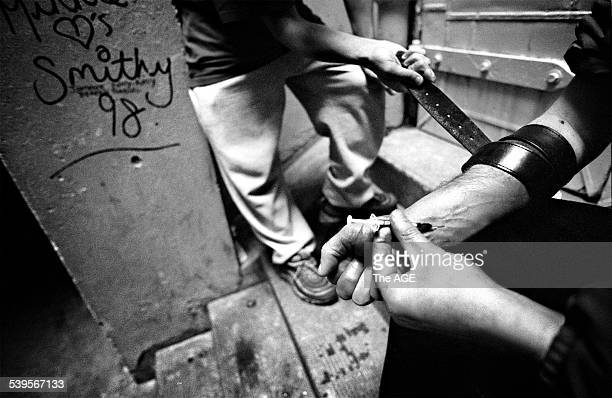 Pic shows a young heroin addict hitting up in an alley in the city. THE AGE NEWS Picture by JASON SOUTH