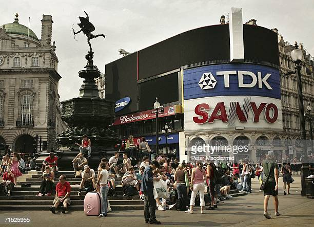 Picadilly Circus' illuminated signs remain switched off after central London suffered a power cut on July 27 2006 in London England Power supplier...