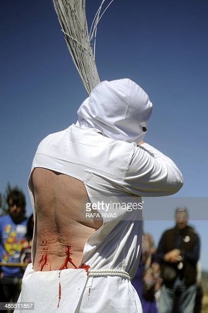 A Picao penitent bleeds after whipping himself during the Santa Vera Cruz brotherhood procession of the Holy Week in San Vicente de la Sonsierra in...