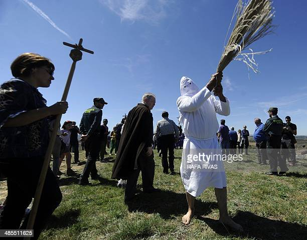 A 'Picao' penitent whips himself during the 'Santa Vera Cruz' brotherhood procession of the Holy Week in San Vicente de la Sonsierra in Northern...