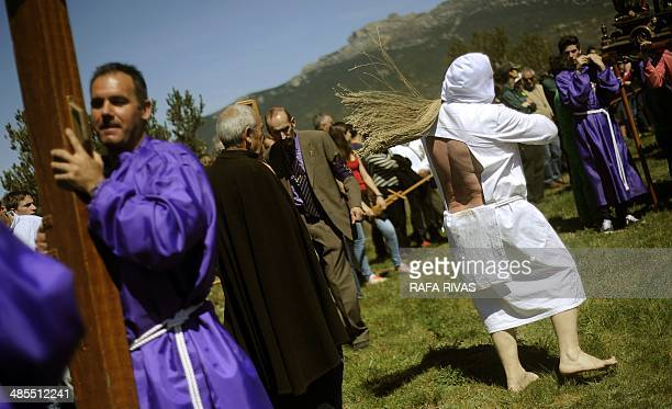 A Picao penitent whips himself during the Santa Vera Cruz brotherhood procession of the Holy Week in San Vicente de la Sonsierra in Northern Spain on...