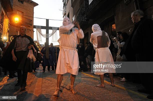 'Picao' penitents whip themselves during the 'Santa Vera Cruz' brotherhood procession of the Holy Week in San Vicente de la Sonsierra in Northern...