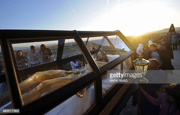 'Picaos' penitents follow a coffin with a figure representing a dead Christ during the 'Santa Vera Cruz' brotherhood procession of the Holy Week in...