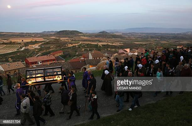 """""""Picaos"""" penitents follow an effigy of a Dead Christ during the procession of the """"Santa Vera Cruz"""" brotherhood in San Vicente de la Sonsierra, 330km..."""
