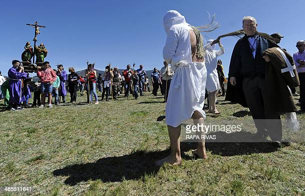 'Picaos' penitents whip themselves during the 'Santa Vera Cruz' brotherhood procession of the Holy Week in San Vicente de la Sonsierra in Northern...