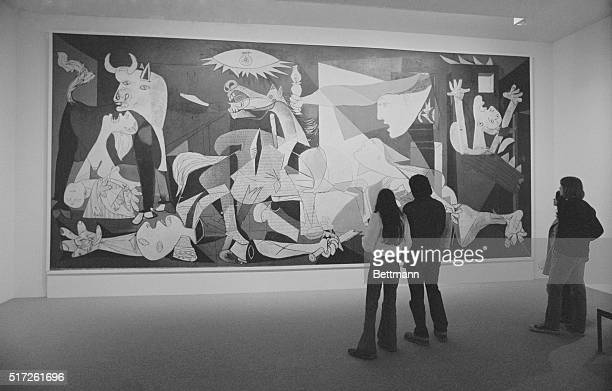 Picasso's Guernica New York Spectators view haunting mural titled Guernica executed in 1937 by Spanishborn painter Pablo Picasso at Museum of Modern...