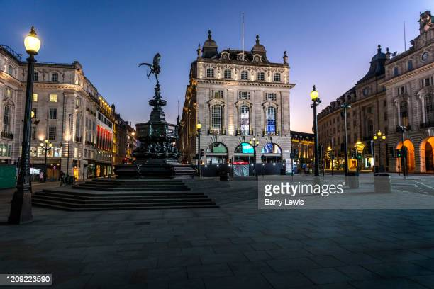 Piccadilly Circus deserted at 730pm Saturday night during the Coronavirus pandemic on 4th April 2020 in London United Kingdom The government...