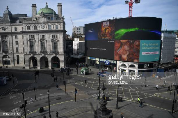 Piccadilly Circus in central London is seen at lunch time on March 21 a day after the British government said it would help cover the wages of people...