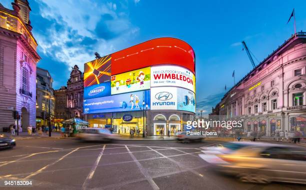 piccadilly circus in london at night. - piccadilly stock pictures, royalty-free photos & images