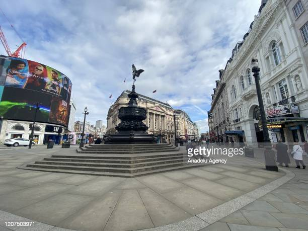 Piccadilly Circus is seen almost empty after UK government updated coronavirus guidance last night and advised people to work from home where is...