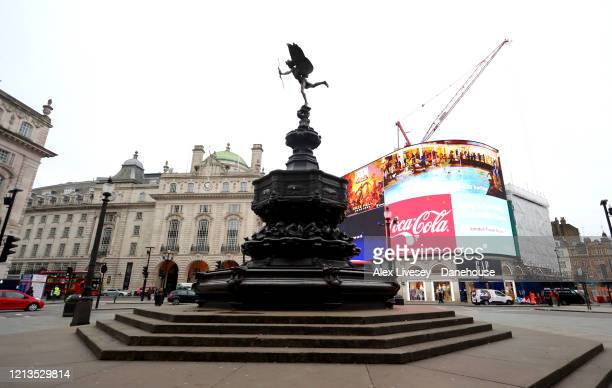 Piccadilly Circus is seen very empty as the UK adjusts to life under the Coronavirus pandemic on March 19 2020 in London England