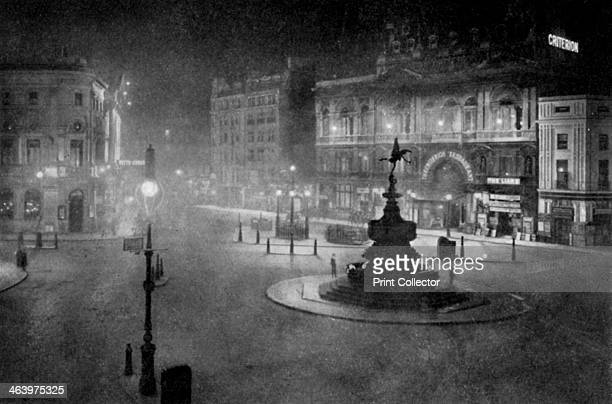 Piccadilly Circus, London, at night, 1908-1909. From Penrose's Pictorial Annual 1908-1909, An Illustrated Review of the Graphic Arts, volume 14,...