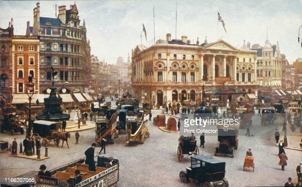 Piccadilly Circus London circa 1910 Opentop omnibuses in the busy thoroughfare with the statue of Eros on the left the top of Shaftesbury Avenue and...