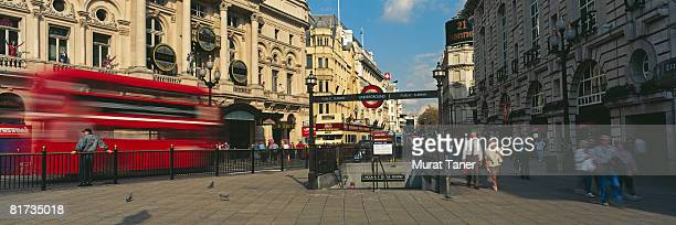 piccadilly circus subway station entrance and street scene, london, england - london underground stock pictures, royalty-free photos & images