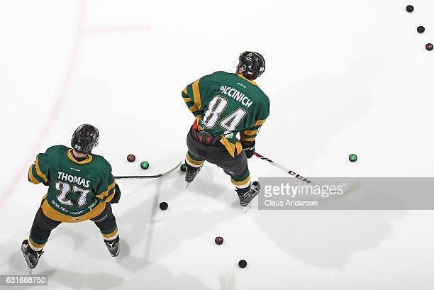 Piccinich and Robert Thomas of the London Knights warm up prior to play against the Saginaw Spirit in an OHL game at Budweiser Gardens on January 13,...