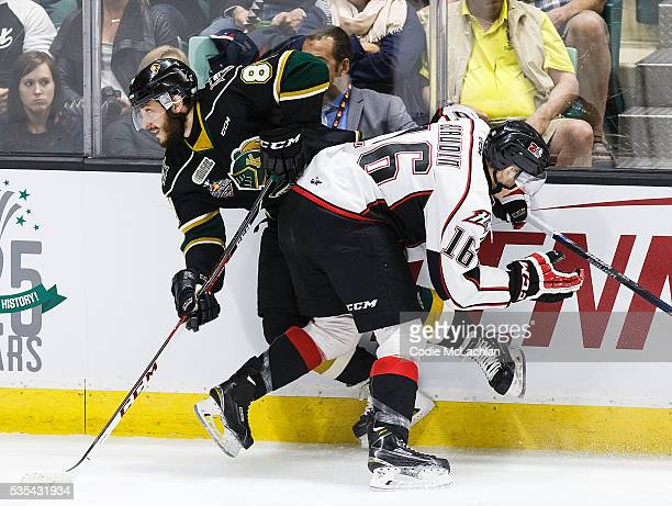 Piccinich of the London Knights collides with Jean-Christophe Beaudin of the Rouyn-Noranda Huskies during the Memorial Cup Final on May 29, 2016 at...