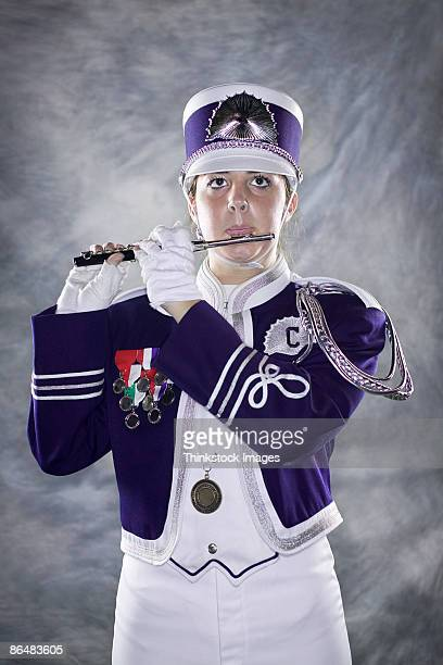 piccolo player in marching band - marching band stock pictures, royalty-free photos & images
