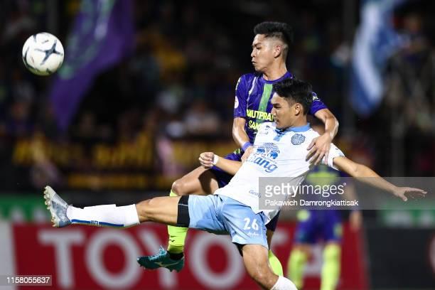 Picha Autra of Samut Prakan City and Rattanakorn Maikami of Buriram United compete for the ball during the Thai League 1 match between Samut Prakan...