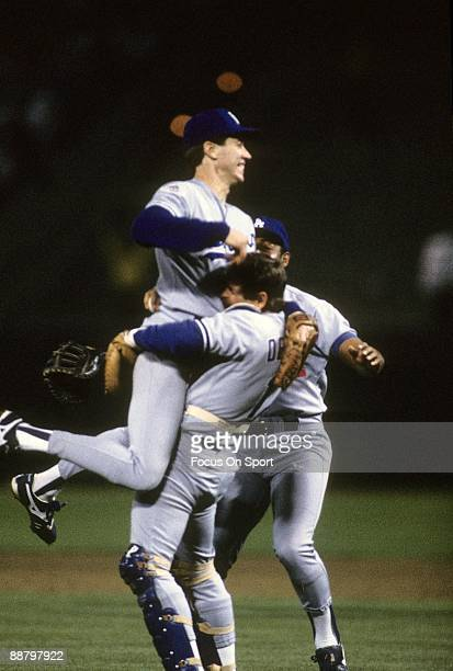 Picher Orel Hershiser of the Los Angeles Dodgers is lifted in the air with jubilation by catcher Rick Dempsey after Hershiser pitched a complete game...