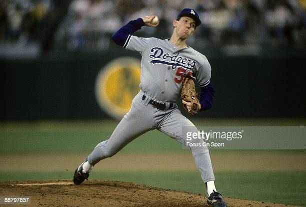Picher Orel Hershiser of the Los Angeles Dodgers throws a pitch against the Oakland Athletics in game 5 of the 1988 World Series October 20 1988 at...