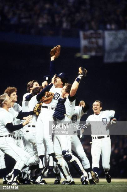 Picher Willie Hernandez and catcher Lance Parrish of the Detroit Tigers celebrate with their teammates after closing game five to win the 1984 World...