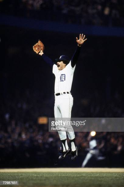 Picher Willie Hernandez of the Detroit Tigers jumps up in the air as he celebrates saving game five to win the 1984 World Series against the San...