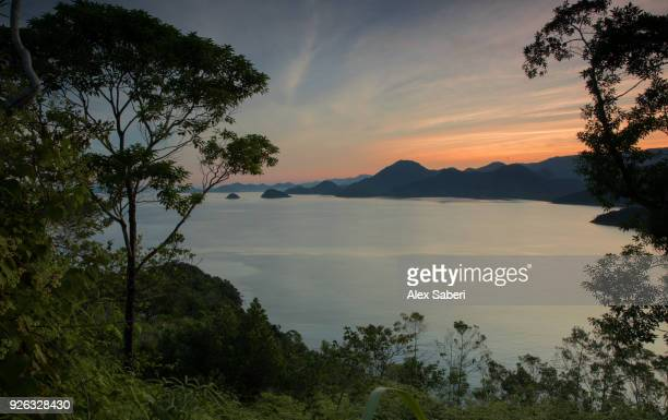 The Atlantic rainforest and Serra do Mar mountains and jungles of Ubatuba beach at sunrise.