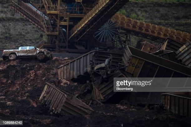 A pick up truck sits among debris after a Vale SA dam burst in Brumadinho Minas Gerais state Brazil on Saturday Jan 26 2019 A Brazilian judge has...