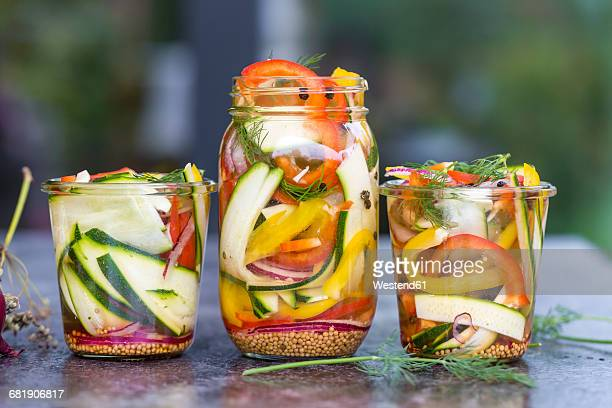 pickeled vegetables and herbs in preserving jar - pickled stock photos and pictures