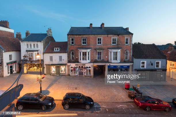 pickering - market place street in a quaint village in yorkshire, england - north yorkshire stock pictures, royalty-free photos & images