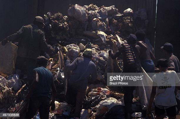 Pickers sort through garbage finding recyclables as a means of survival at Metropolitan Landfill of Jardim Gramacho in Duque de Caxias city one of...