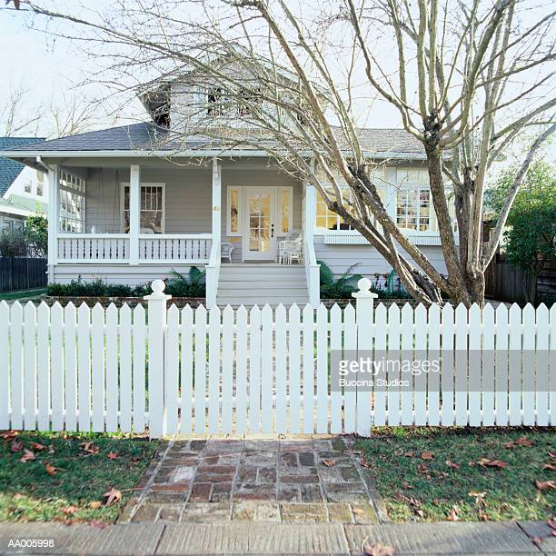 picket fence in front of a house - bare tree stock pictures, royalty-free photos & images