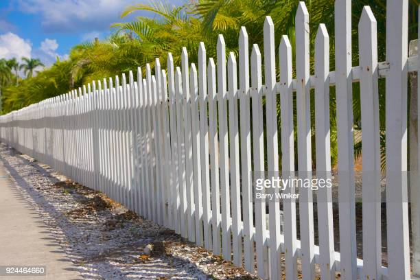 picket fence seen from street in a low angle in ft. myers - barry wood stock pictures, royalty-free photos & images