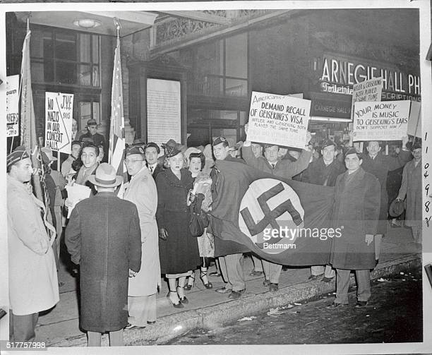 A picket which included members of the Jewish war veterans and musicians' branch of the American Veterans Committee paraded in front of Carnegie Hall...