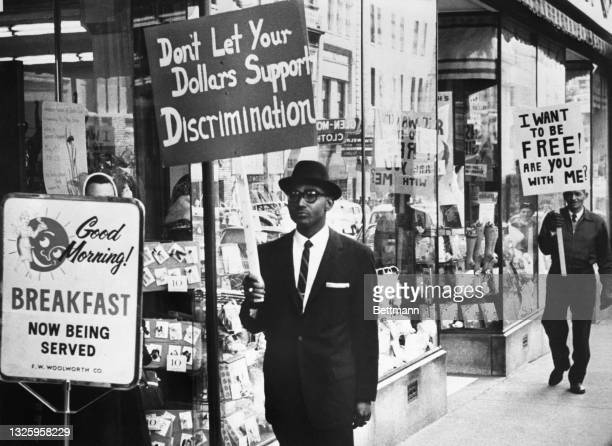 Picketers demanding an end to lunch counter segregation made their first appearance outside a Woolworth store in Lynchburg, VA. Reverend Virgil Wood,...
