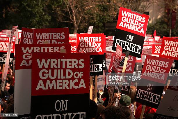 Picketers march during a strike held by the Writers Guild of America outside Fox Studios on November 9 2007 in Century City California Over 12000...
