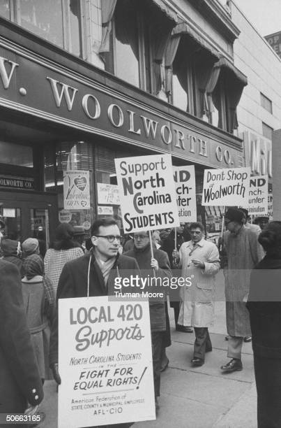 Picketers outside Woolworth store in Harlem during a sympathy demonstration in support of desegregation in the South