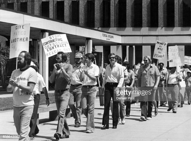 Picketing Pickets Denver Federal employees from various unions march in front of the Federal Building and Courthouse Thursday Charles Carter...