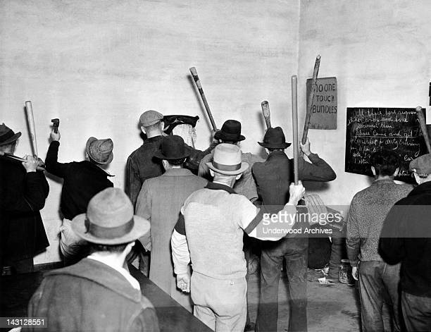 Pickets arm themselves with bats, sticks, wrenches, etc , as they prepare to take up duty at the cannery strike line, Stockton, California, April 23,...