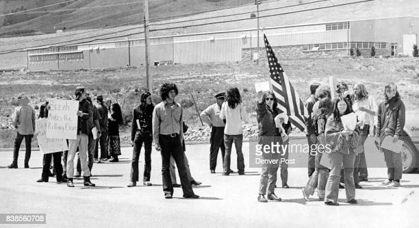 Pickets at Beech Plant 6 Miles North of Boulder Rap 'War Profits' Part of approximately 40 young persons most of them University of Colorado students...
