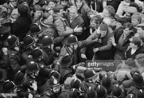 Pickets clash with police outside the National Union of Mineworkers headquarters, Sheffield, UK, 13th April 1984.