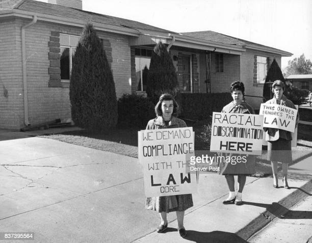 Pickets from core march at Raye Bronstine Home From left are Mrs Helen Wolcott Miss Turg Westbrooks and Mrs Mary Ella Rapp carrying their protest...