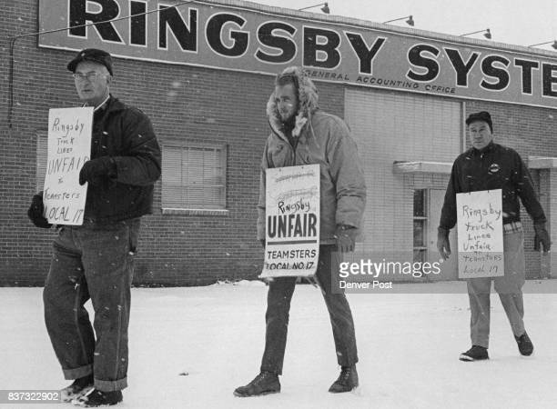 Pickets from left Harry Eagan Mike Riddle and George Sabell show Teamsters' Displeasure Some members of Line Drive Local 961 picketed Ringsby System...