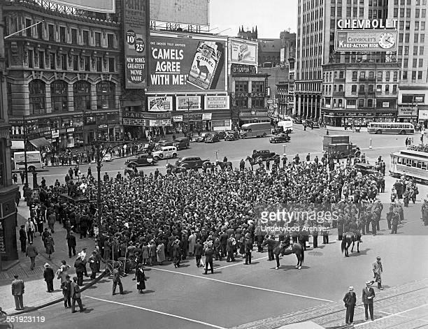 Pickets gathered at Columbus Circle after marching along Columbus Avenue protesting Work Progress Administration policies, New York, New York, May...