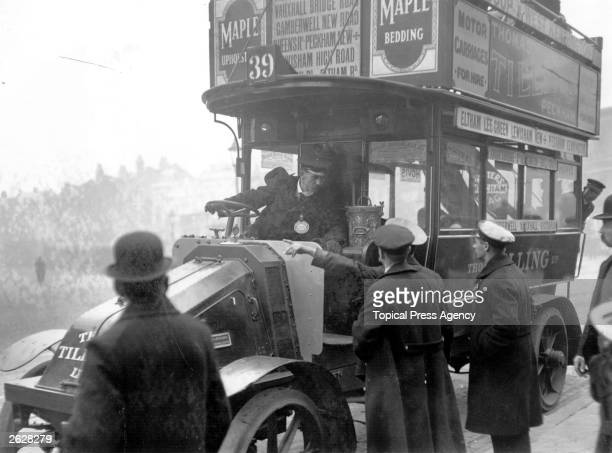 Pickets hold up a bus driver during the motor bus strike Camberwell London