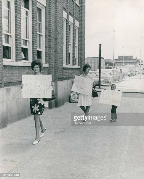 Pickets Protest Mandatory Busing Three mothers and two of their children Friday afternoon picketed the Denver Public Schools Administration Building...