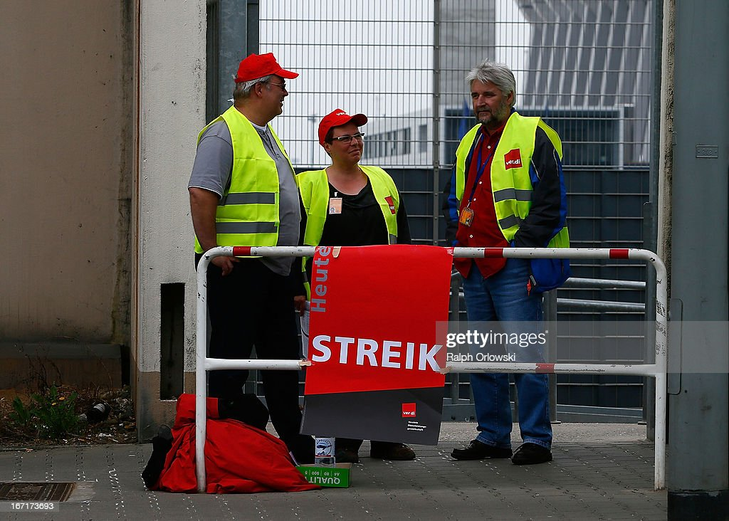 Pickets stand at a gate to Lufthansa cargo during a nationwide strike by Lufthansa ground, service and maintenance personnel at Frankfurt Airport on April 22, 2013 in Frankfurt, Germany. Workers are demaning pay raises and job guarantees and today's strike has forced Lufthansa to cancel approximately 1700 flights.