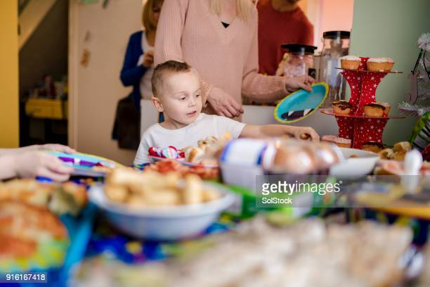 picking the party food - paper plate stock photos and pictures